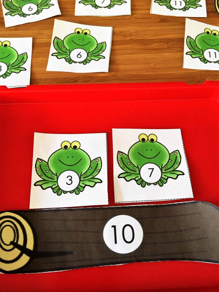 Addition game math activity mat with logs and toads. Use a fun game to help children practice their counting and addition skills using this free game.