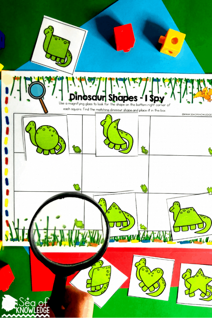 This activity is so much fun! Kids will love the 'I spy' aspect using magnifying glasses to find the dino then identify the shapes! This game mat can be played with kids as young as 3.  Kids will use a magnifying glass to identify the shape in the box, then place the matching shaped dinosaur into the box. Use velcro dots here on the boxes and the cards so that the kids can play this over and over! #shapesactivities #preschool #preschoolteacher