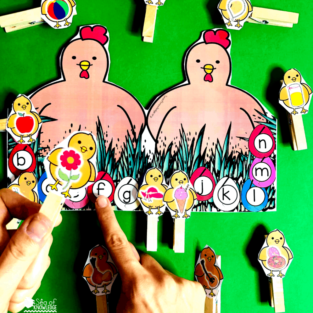 Fantastic Fine Motor Easter Centers for Preschoolers. This simple yet FUN activity will get the kids identifying letter sounds and matching the images to the letters on each egg (as they hatch). So much fun! This will have the kids working on their fine motor skills using the pegs. Be sure to laminate those chick cards so they hold up on repeated use. #preschoolteachers